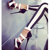 shoes,platform high heels,black and white,b&w,strappy heels,high heels,black high heels,cute high heels,platform shoes,black platforms,white platforms,strappy black heels,strappy sandals,fashion trend,black and white tights,bows on shoes
