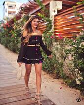 skirt,tumblr,mini skirt,black skirt,pom poms,matching set,top,black top,off the shoulder,off the shoulder top,long sleeves,sandals,flat sandals,bag,pouch,shoes