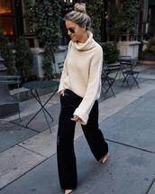 sweater,knitted sweater,oversized sweater,turtleneck sweater,pants,wide-leg pants,pumps,earrings,aviator sunglasses,shoulder bag
