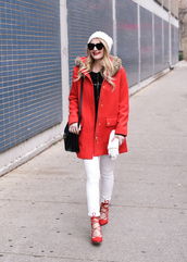 visions of vogue,blogger,shoes,coat,sweater,jeans,bag,hat,gloves,sunglasses,make-up,red coat,beanie,winter outfits,shoulder bag,red heels,white jeans,white pom pom beanie