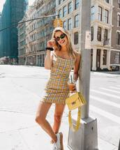 bag,yellow bag,mini dress,black sunglasses,platform sneakers