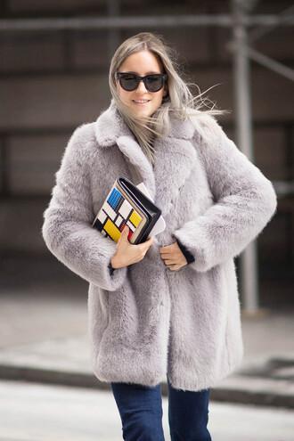 the fashion guitar blogger faux fur coat lilac pouch colorblock coat bag sunglasses jeans