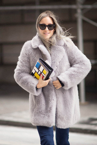 the fashion guitar blogger faux fur coat lilac pouch colorblock coat bag sunglasses jeans
