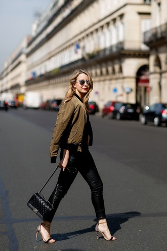 caroline louis pardonmyobsession blogger jacket pants shoes bag sunglasses bomber jacket green bomber jacket army green jacket black jeans shoulder bag sandals sandal heels