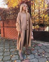 coat,long coat,wool coat,oversized coat,ankle boots,suede boots,pants,sweater,earrings,sunglasses,glasses,handbag