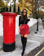 bag,mini bag,crossbody bag,chain bag,thigh high boots,black boots,black blouse,sunglasses,mini skirt,wrap skirt,polka dots
