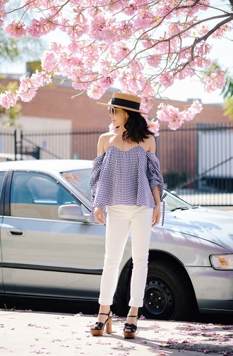hallie daily blogger hat sunglasses white jeans stripes off the shoulder black heels spring outfits