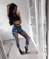 jeans,blue,black,ripped jeans,high waisted jeans,blue jeans,fishnet tights,black top,black crop top,jewels,jewelry,girl,sneakers,nike,adidas