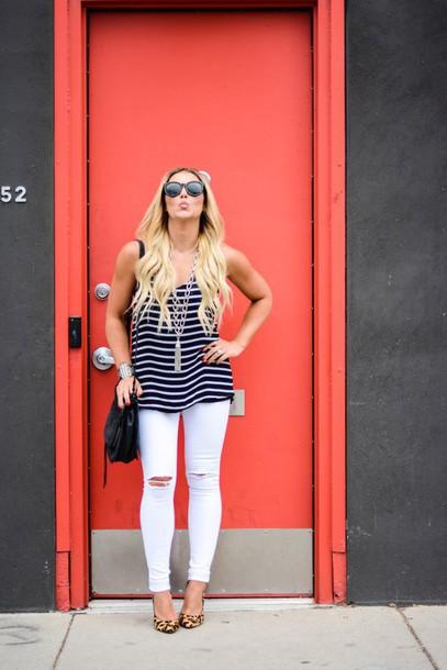 all dolled up blogger top jewels jeans bag sunglasses shoes stripes striped top blue top skinny jeans ripped jeans shoulder bag black bag animal print statement necklace