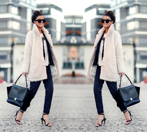 stylista blogger bag fuzzy coat striped pants