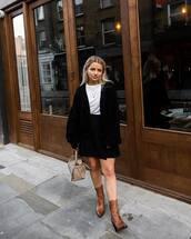 bag,leather bag,handbag,ankle boots,leather boots,cardigan,knitted cardigan,mini skirt,black skirt,pleated skirt,white t-shirt,earrings