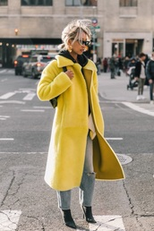 coat,yellow,black boots,sunglasses,yellow coat,streetstyle,jeans,boots
