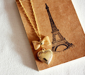 jewels,jewelry,heart,bow,gold locket,eiffel tower,necklace,beautiful jewelry,locket,bows,accessories,Accessory,gold,gold chain,gold necklace