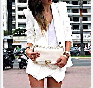 skirt white skorts white skort wrap skort like fab glamour pretty cool girly beautiful jacket bag jewels shorts chanel bag blazer t-shirt class white skirt white shorts fashion blogger white lace shorts coat classy tank top white jacket white blazer pointy shoulder pads chanel ad asymmetrical shorts chanel des vêtements white chanel bag white top gold jewelry white bralette sheer blouse