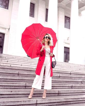 laminlouboutins blogger coat top shoes sunglasses bag white pants pumps red coat trench coat umbrella heart umbrella