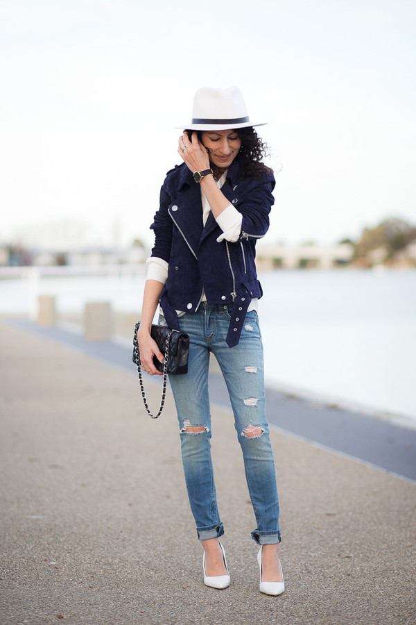 ripped jeans alterations needed white heels blogger spring outfits felt hat shoulder bag perfecto black bag