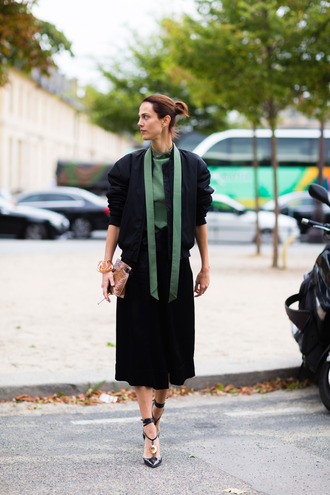 jacket green top fashion week street style fashion week 2016 fashion week paris fashion week 2016 midi skirt black skirt bomber jacket black bomber jacket sandals high heels black heels shoes black shoes top streetstyle work outfits