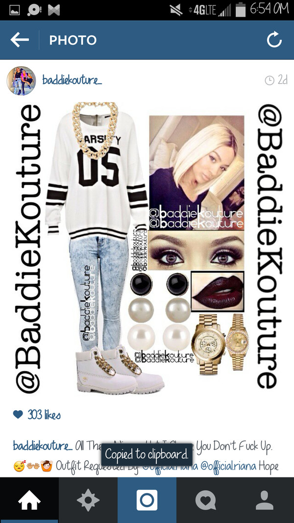 varsity baddiekouture_ outfit idea jewels jeans outfit ootd gold chain number baseball tee timberland white timberlands gold watch black and white burgundy lipstick eye makeup