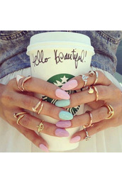 jewels,ring,jewelry,gold,knuckle ring,starbucks coffee,nails,nail polish,pastel,mint,pink,lavender,gold midi rings,rose gold ring,nail accessories,nalis,rings and tings,home accessory