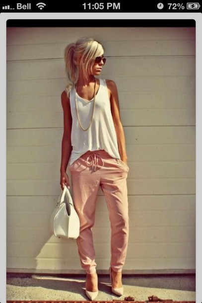 pants pink pants blush pink harlem pants cinched waist pink baggy boho summer blouse shoes shirt whole outfit.. peach pants loose pants beautiful white top top fall outfits pants casual white tank top earphones jeans white tank top bag white bag spring outfits high heel pumps pumps nude pumps sunglasses