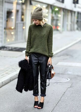sweater green beanie green sweater leather pants black mules black and gold handbag blogger