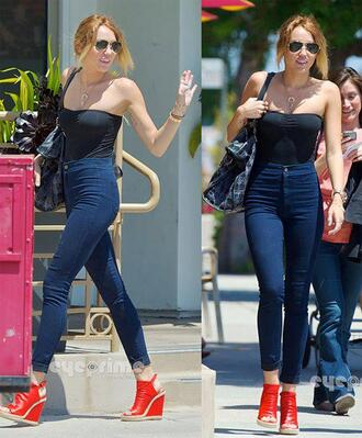 jeans high waisted high waisted jeans miley cyrus blue skinny jeans red shoes corset top sunglasses pilot glasses shirt clothes