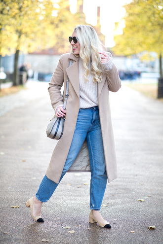 coat tumblr nude sweater camel camel coat jeans denim blue jeans mom jeans shoes pumps pointed toe pumps cap toe mid heel pumps bag grey bag sunglasses winter work outfit