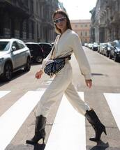 jumpsuit,long sleeves,black boots,high heels boots,leather shoes,crossbody bag,sunglasses