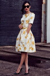 gary pepper vintage,dress,bag,jewels,shoes,vintage,with pocekts,knee length,knee length dress,clothes,where can i get this adorable dress?,floral dress,yellow dress,black sunglasses,gary pepper girl,wedding guest,white dress,romantic dress,summer dress,elegant dress,sunglasses,pumps,pointed toe pumps,black pumps,metallic clutch,clutch,louboutin,mustard dress,midi dress,printed dress