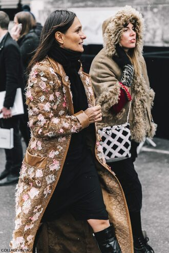 coat tumblr fashion week 2017 fashion week street style streetstyle printed coat camel long coat long coat printed long coat black dress dress black midi dress midi dress scarf jacket bag printed bag furry bag gloves knitted gloves