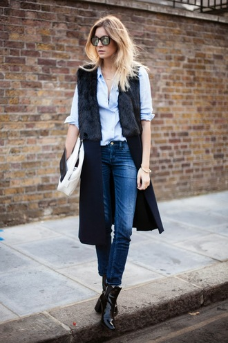 camille over the rainbow blue shirt sleeveless coat black coat skinny jeans patent shoes patent boots boots mirrored sunglasses ankle boots black boots blue jeans fur vest vest black vest fall outfits work outfits office outfits winter work outfit blogger