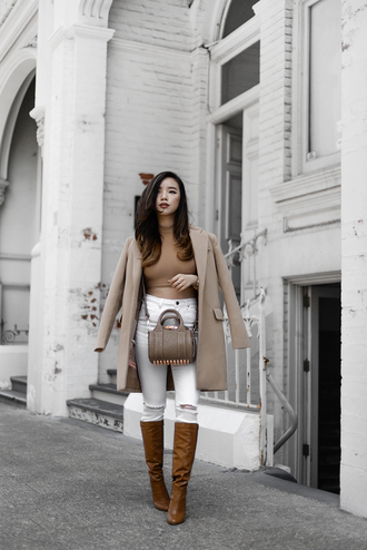 pale division blogger bag white jeans brown boots nude coat winter outfits