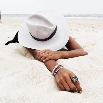 jewels bracelets diamonds hat felt hat printed bucket hat floppy hat bucket hat sun hat white white hat tan beach jewelry hand jewelry ring engagement ring silver ring statement ring