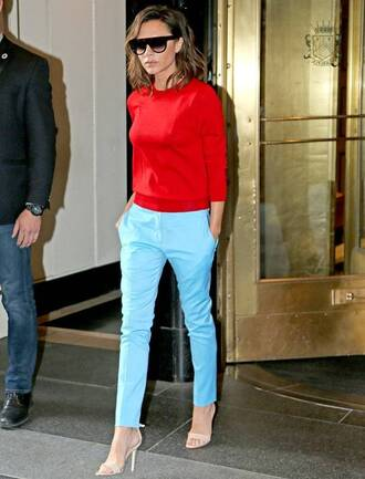 sweater celebrity work outfits work outfits red top red sweater office outfits pants blue pants light blue sandals sandal heels high heel sandals nude sandals sunglasses black sunglasses celebrity style celebrity victoria beckham