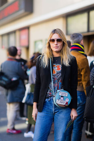 bag fashion week street style fashion week 2016 fashion week paris fashion week 2016 round bag printed bag graphic tee t-shirt black t-shirt black blazer blazer denim jeans blue jeans sunglasses streetstyle model camille rowe band merch
