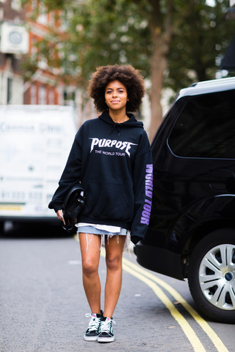 sweater fashion week street style fashion week 2016 fashion week london fashion week 2016 black sweatshirt sweatshirt hoodie black hoodie skirt denim skirt blue skirt mini skirt sneakers black sneakers vans bag black bag
