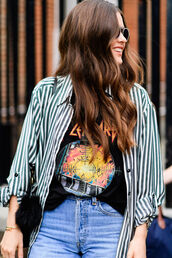 shirt,fashion week street style,fashion week 2016,fashion week,streetstyle,london fashion week 2016,striped shirt,stripes,t-shirt,graphic tee,black t-shirt,jeans,blue jeans,band merch,band t-shirt,long hair,wavy hair,brunette,stripe shirt