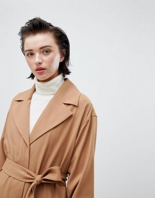 Weekday oversize belted trench coat in camel at asos.com