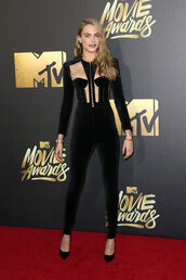 jumpsuit,black,sexy,cara delevingne,pumps,mtv movie awards,top,bustier,long sleeves,black heels,shoes,pants,velvet