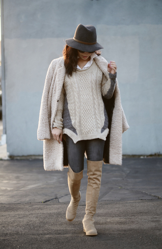 hallie daily blogger cable knit oversized sweater winter sweater winter outfits fuzzy coat fedora suede boots