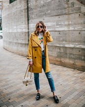 coat,yellow coat,sunglasses,loafers,black shoes,bag,white bag,trench coat,jeans,black jeans,denim,shoes
