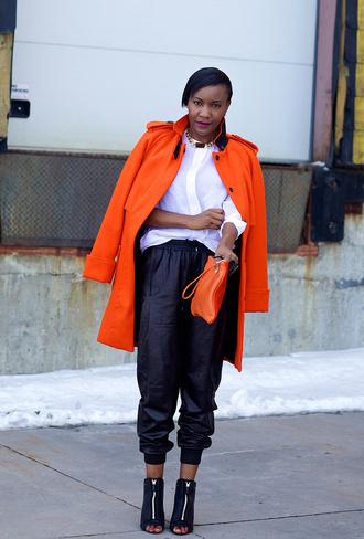 coat orange coat white shirt black trousers black cutout heels blogger orange purse