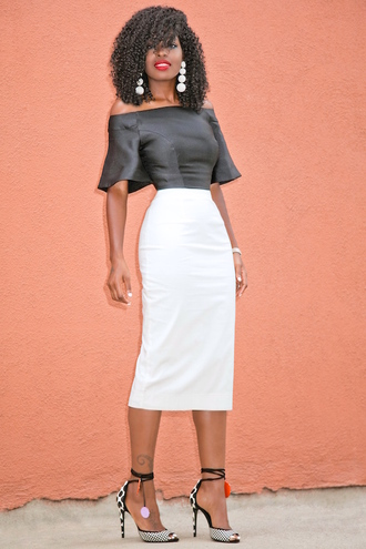 blogger blouse jewels shoes black blouse white skirt off the shoulder pencil skirt statement earrings black heels black girls killin it black girls slayin printed sandals sandals sandal heels high heel sandals off the shoulder top bell sleeves pompon earrings