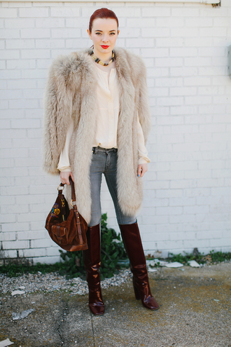 sea of shoes blogger winter outfits fur coat brown leather boots blouse jeans shoes bag