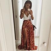 skirt,slit skirt,long skirt,red skirt,african skort,flowy skort,white crop tops,crop tops,printed skirt,african skirt,african print skirt,african dress,dress,maxi skirt,african print,african style,african designs,red,gold skirt,gold,split skirt,side split,where could i get the exact skirt or similar skirt to this,shirt