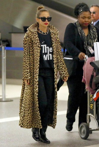 shirt necklace red lips sunglasses black coat leopard print nicole richie band t-shirt the who t-shirt hair updo animal print leopard print coat boots black boots leather boots hair bun animal print coat vintage coat chettah print all black casual simple printed tee