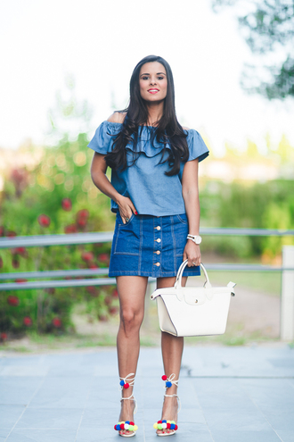 crimenes de la moda blogger top skirt jewels shoes bag off the shoulder ruffle ruffled top denim top denim skirt button up skirt mini skirt white bag lace up heels summer outfits white sandals all denim outfit all blue outfit pom pom sandals blue off shoulder top