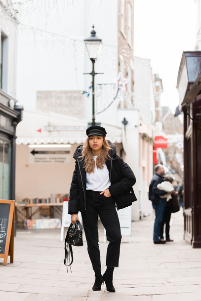 a style diary blogger coat jeans t-shirt shoes hat bag boots handbag winter outfits puffer jacket black pants