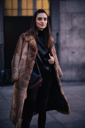 coat london fashion week 2017 fashion week 2017 fashion week streetstyle brown brown coat fur coat top black top satin denim jeans black jeans skinny jeans boots black boots over the knee boots bag