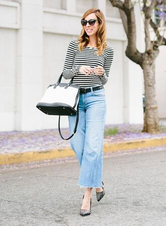 jeans black and white striped shirt flared jeans black bag black studded heels blogger sunglasses
